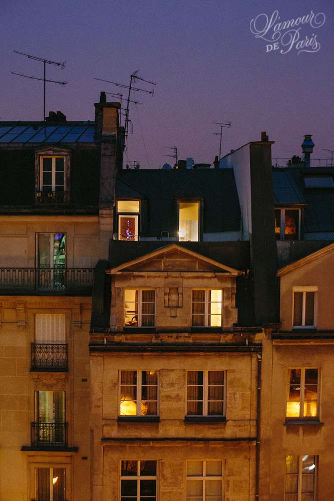 Romantic photo of glowing windows during sunset in Paris
