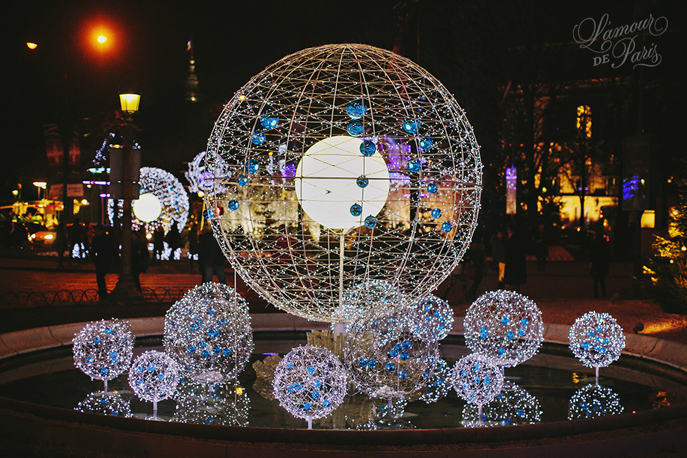 Photos of the nighttime views of the holiday lights on the Champs Elysees during Christmas in Paris