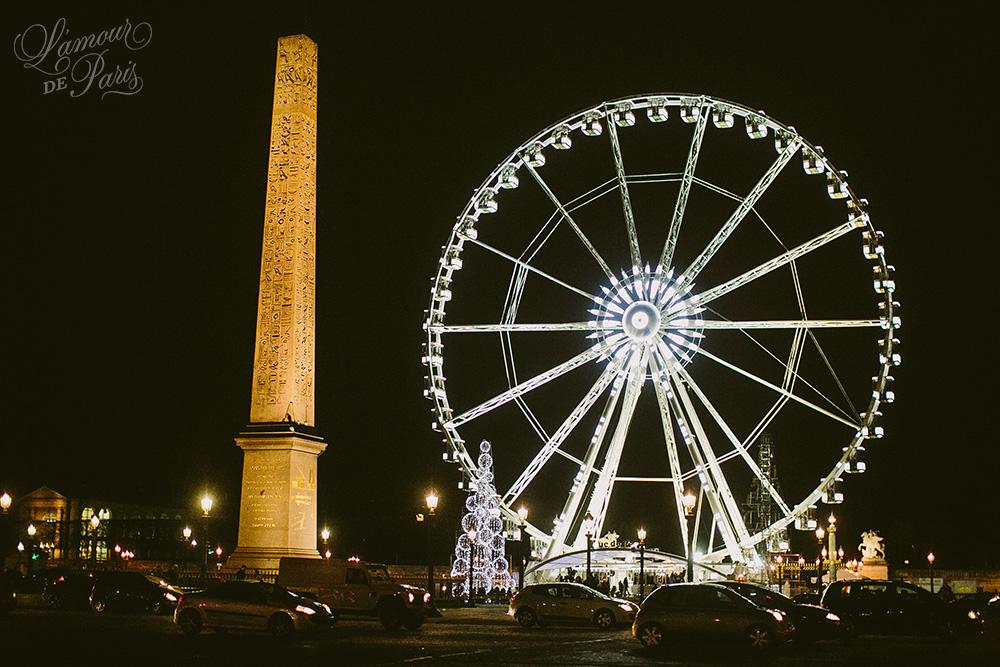 Landscape city views of Paris by night from the ferris wheel Roue de Paris