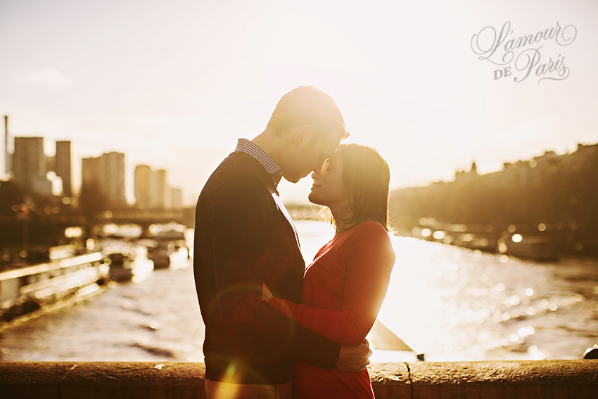 Glowing romantic sunset portrait of Alison Zieske and Adam Preiss on the Seine River by Paris wedding photographer Stacy Reeves for L