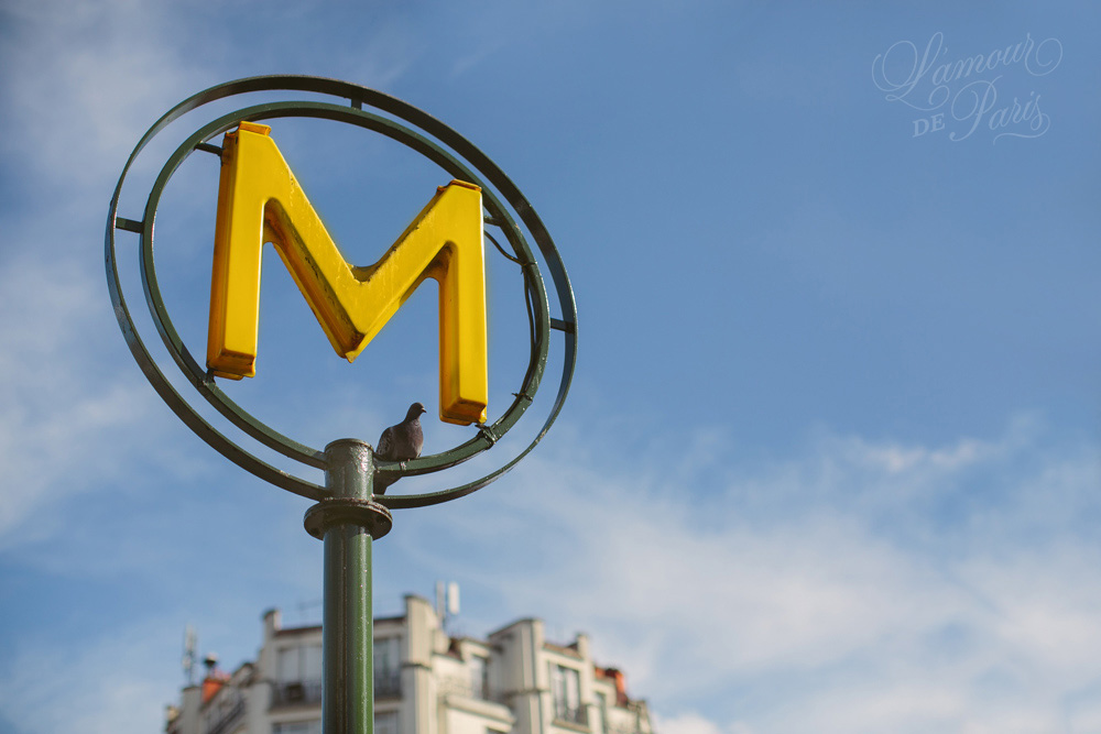 Paris metro sign on a sunny day