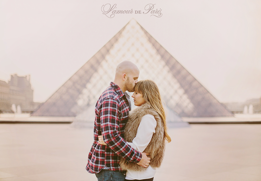 Romantic portraits of Helen and Sam Byrd is front of the Musee du Louvre by Paris wedding photographer Stacy Reeves for L