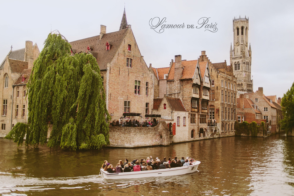 Tourist sightseeing boats on the canals in Brugge or Bruges, Belgium