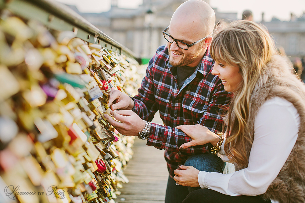 Romantic portraits at the Louvre, Pont des Arts Bridge, and Seine River in Paris by wedding photographer Stacy Reeves