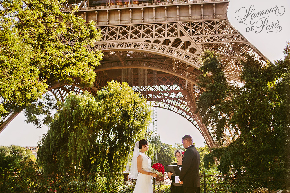 Paris elopement wedding ceremony in front of the Eiffel Tower by Paris wedding photographer Stacy Reeves