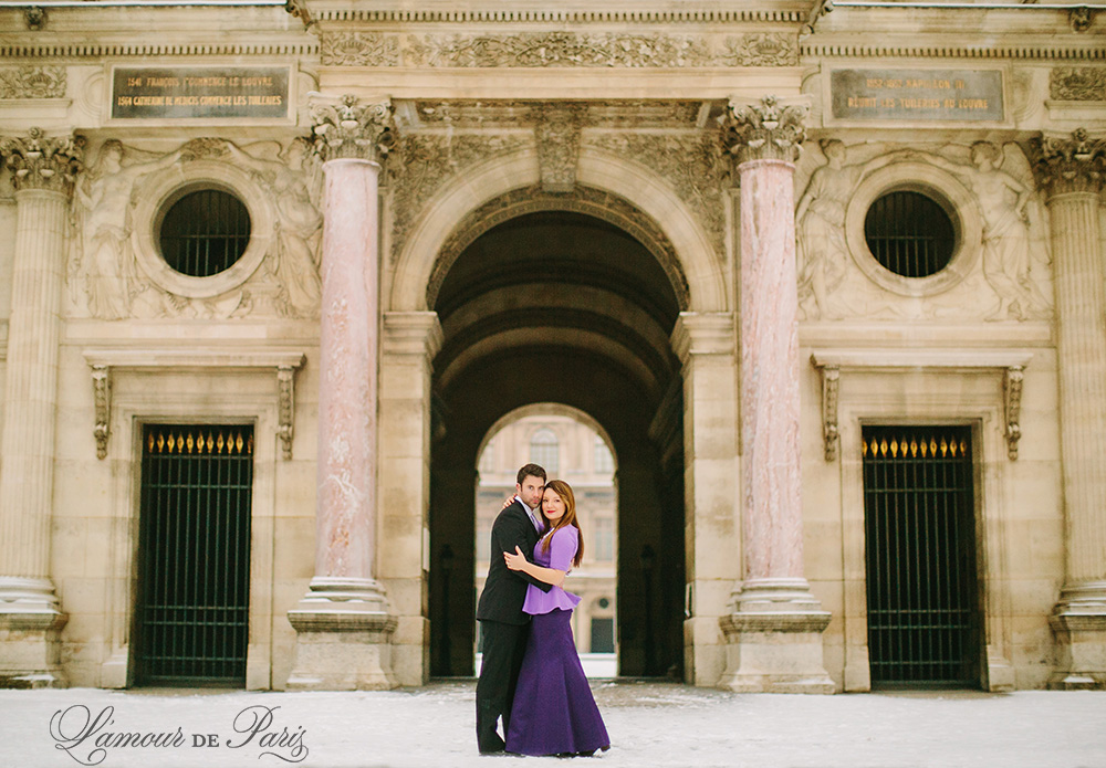 Couples portrait session at the Louvre in Paris during snow in winter